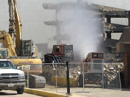 Illinois demolition firm smothers dust from garage takedown